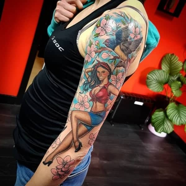 pin up tattoo bicep and forearm