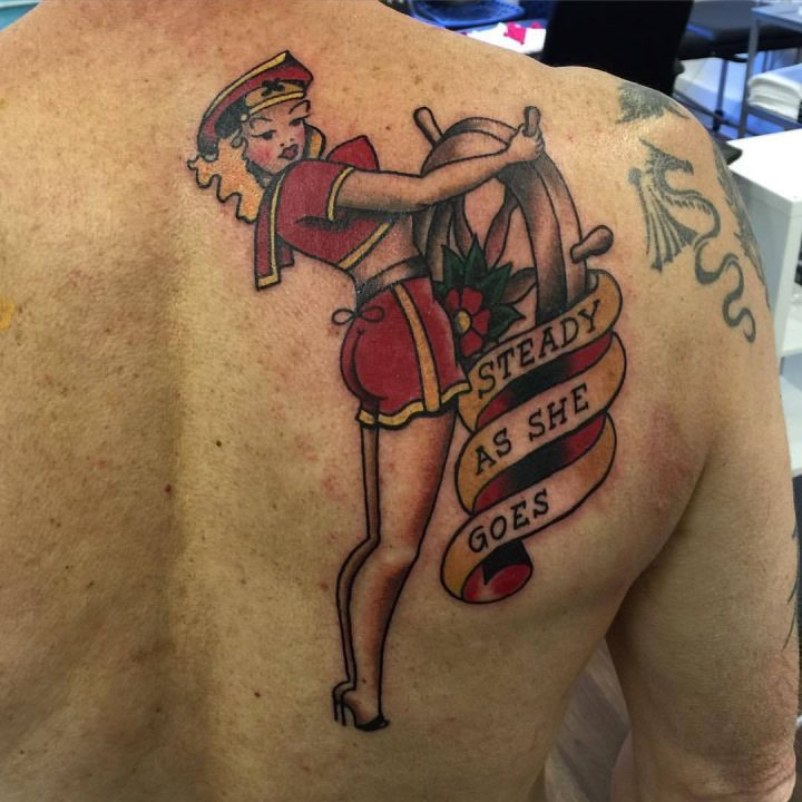 sailor girl pinup tattoo on shoulder blade