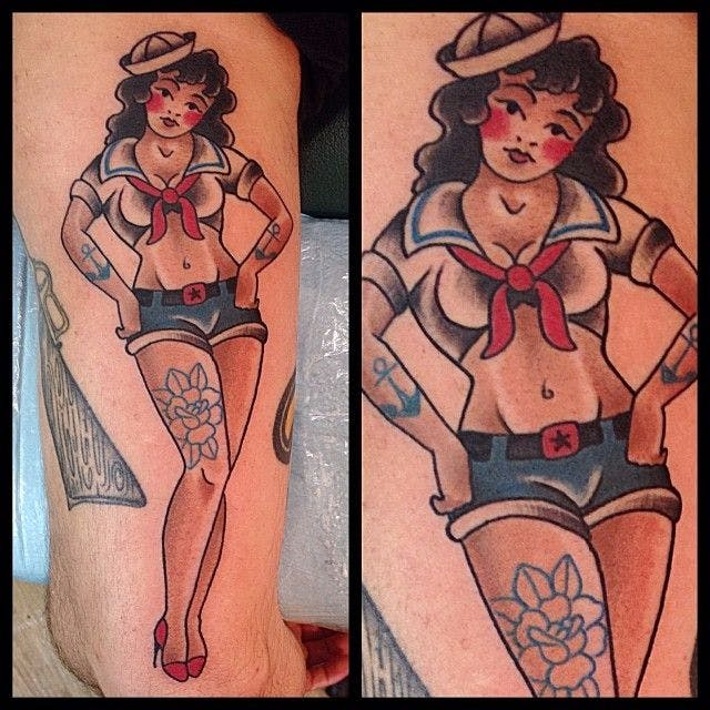 sailor girl pin-up tattoo on bicep