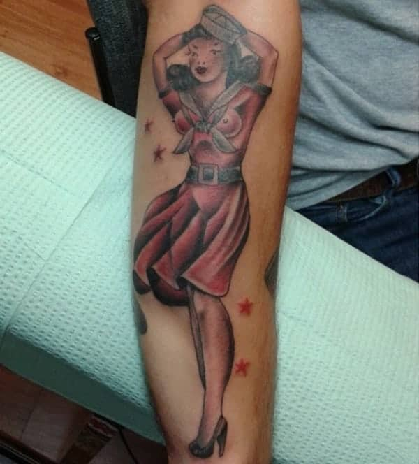 sailor jerry pin-up tattoo on forearm
