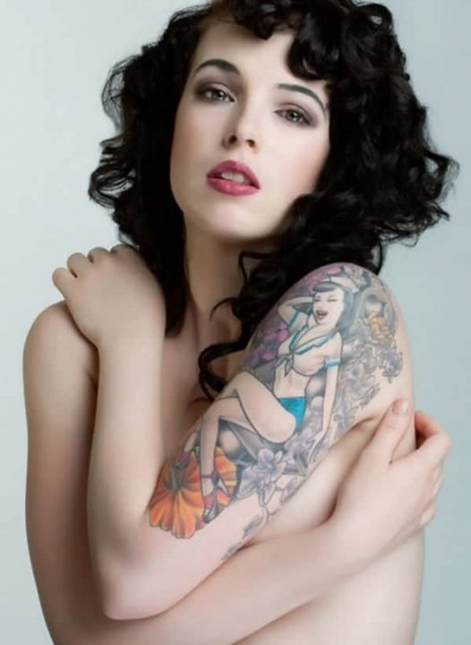 woman with pin-up tattoo on arm